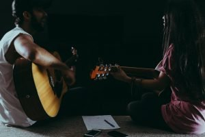 man-and-woman-playing-guitar-1164763.jpg